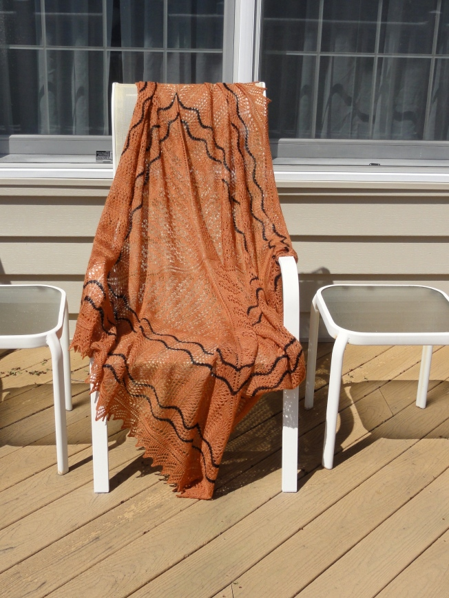 Calico Cat's Paw Square Shawl on a chair