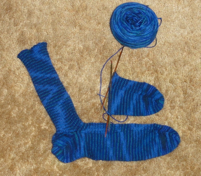 Greg's second 3 x 2 ribbed sock is well under way.