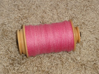 The 3-ply yarn on the bobbin