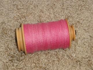The 3-ply yarn on the bobbin
