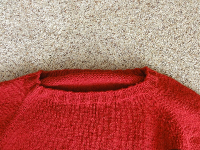 The curl should disappear when the sweater is blocked.