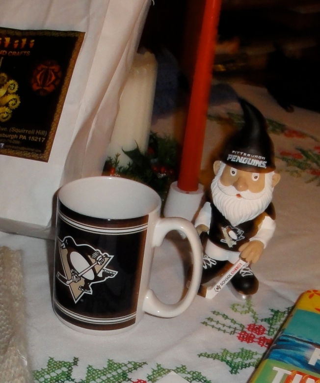 Mug from my son next to the gnome from Emily's mom