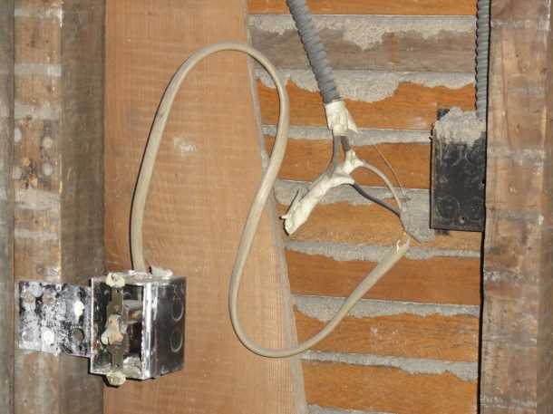 I'm not an electrician, but even I know that this isn't up to code.