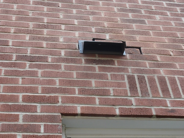 The bricks still need to be mortared, but I'm happy that my range hood will be vented outside