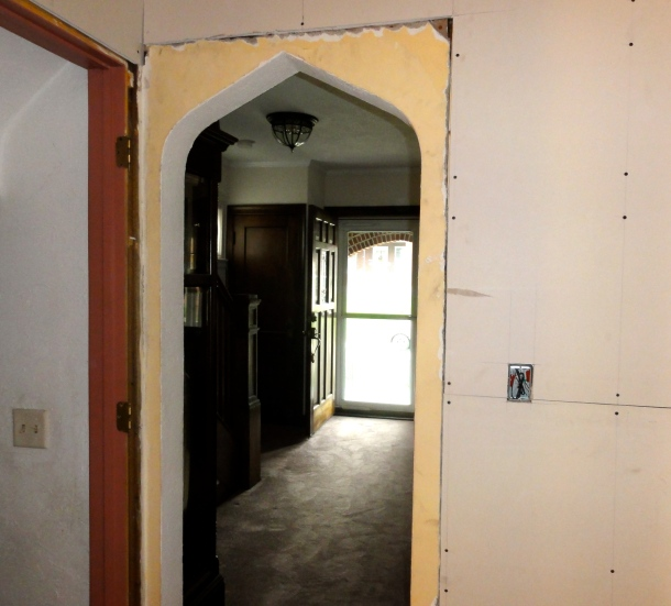 Drywall butting against plaster in the doorway