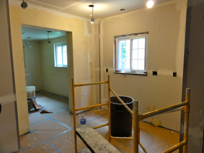 Things don't look too messy after the first day of drywall finishing.