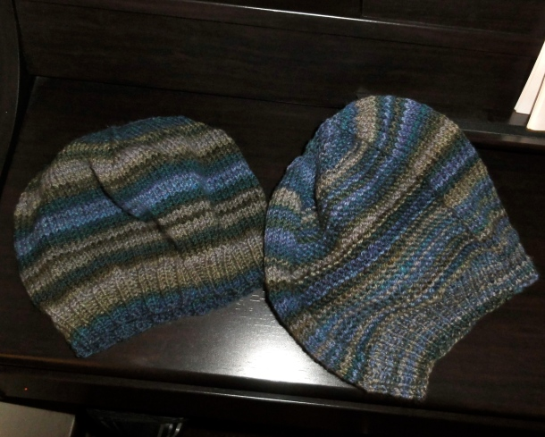 Two hats knitted from the Andraste color way from Into The Whirled.