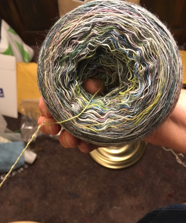 Here's the center-pull ball I wound to make a 2-ply yarn from Northern Lights. I kept it on my thumb so that the ball wouldn't collapse on itself and make a hopelessly tangled mess.