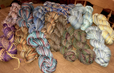 I ended up spinning up 14 4-ounce bumps of fiber. Every bump was a different variety of wool or a different blend. I see lots of knitting in my future.
