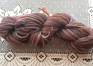 This was probably my favorite spin of the entire Tour de Fleece. The fiber is Po-Mo-Silk, a blend of Polwarth sheepswool, mohair (which comes from goats), and silk. It is incredibly soft and had a beautiful luster that you cannot see in the picture, and it drafted like butter. I divided the bump into narrow strips, spun them end to end, then chain-plied the singles. I'm happy to say that I have another bump of this fiber waiting to be spun. FWIW, the picture does not even come within a million miles of doing this yarn justice.
