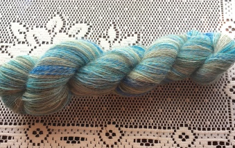 This beautiful 2-ply yarn is Wensleydale, which is a lustrous longwool that requires special handling when being spun and plied. The spinner must take care not to put too much twist into the yarn, or she will end up with twine. But if you spin it with a light hand, you get a surprisingly soft and lustrous yarn that is next-to-the-skin wearable for many.