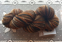 BFL is not my favorite fiber to spin because it is usually very neppy, and I hate having to constantly stop to pick out nepps. But this particular prep had very few nepps, so it was lovely to spin. But BFL is one of the nicest wools to knit and to wear. It is incredibly soft and just lovely, almost like cashmere. I split this bump into thin strips, spun end to end, then chain-plied them to make a self-striping yarn that reminds me of my late calico kitty, Loretta.