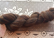 This skein is Icelandic wool. Like Falkland wool, Icelandic wool isn't a specific breed of sheep but rather wool that comes from sheep in Iceland. Although I really like the look and feel of the finished yarn, I didn't enjoy spinning this yarn at all. I found it difficult to draft. Although it has a similar feel to English Shetland, it doesn't spin like English Shetland. Fortunately, the finished yarn was worth the effort it took to spin it.