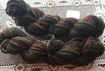 This yarn wanted to be spun thick and thin. It's Manx Loaghton, which I have spun before, but for some reason, this particular prep didn't want to draft smoothly. But that's okay because I had fun doing the thick and thin and I ended up with a really cool yarn. I'm not wild about the colors; it has kind of a camo look. But the yarn itself it great.